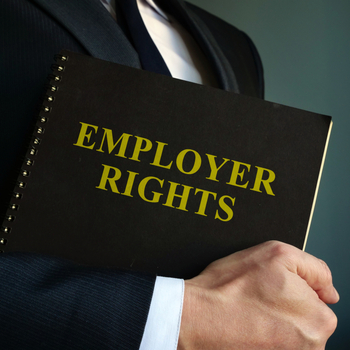 man holding book that has employer rights printed on the front