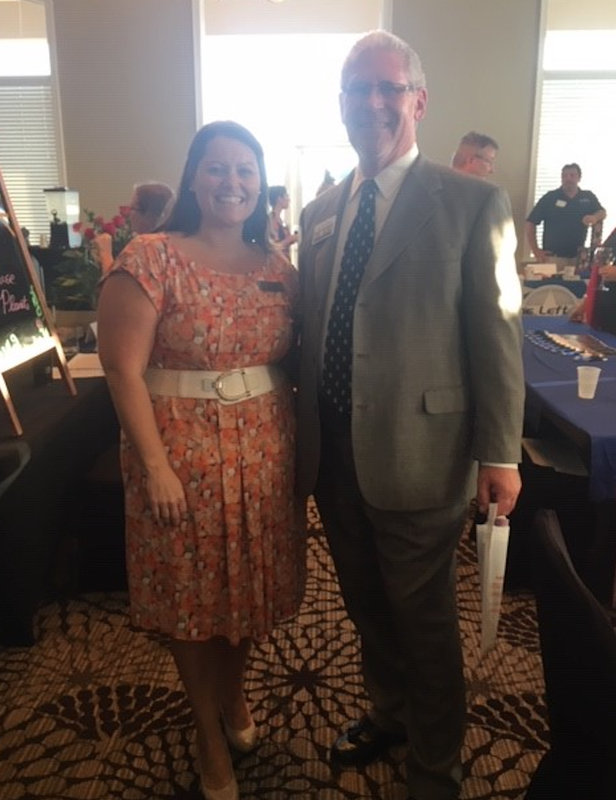 The picture features David Jones, Esq. of Volk Law Offices and Amy McGrew, Director of Catering for the Crowne Plaza Melbourne Oceanfront hotel.